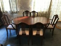 Hardwood dinning table and six chairs.