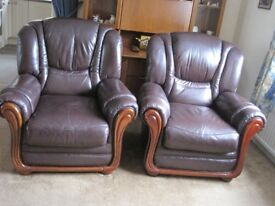 Pair of dark brown leather armchairs in very good condition