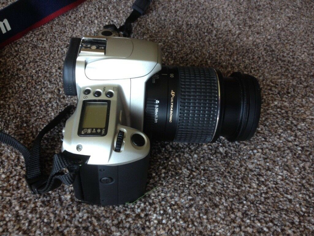 Cannon EOS 300 Rebel 2000. Includes camera bag and 3 film reels.