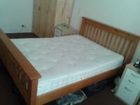 Wooden double bed with mattress is for sale London £150