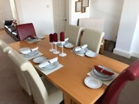 Beech table with 6 leather chairs (2 blood red leather chairs 4 x cream leather chairs)