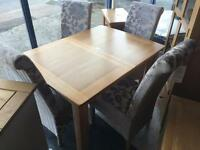 Ex-display/seconds**extendable solid oak table and 4 fabric chairs--ONLY £450