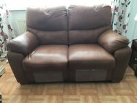Leather 2 seater sofa with swing out footrests.