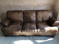 Brown leather Chesterfield style sofa, armchair and foot stool.