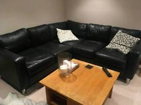 Black leather corner sofa and chair