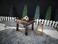 INDONESIAN WOOD SIDE/COFFEE TABLE VERY SOLID TABLE AND IT'S IN VERY GOOD CONDITION