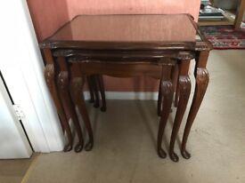Dark wood nest of three tables