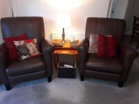 2 brown leather reclining armchairs. VGC. First to see will buy.