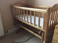 Lovely wooden swinging crib.