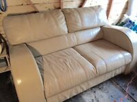 3 piece suite with foot stool. Cream leather Good condition. Large sofa.