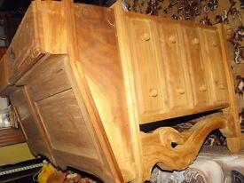 unstained wooden bureau,