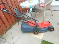 lawn mower just under year old