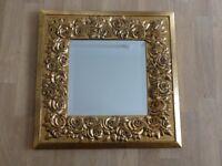 Mirror with embellished gold floral design