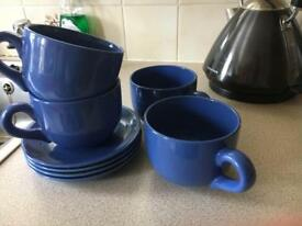 4 oversized tea cups and saucers