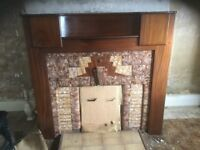 Dark coloured wooden fireplace surround, good condition.