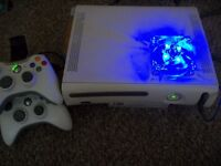 Xbox 360 with 40 games. (would consider swaps)