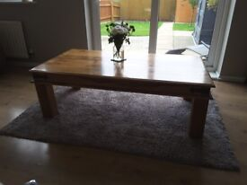 Wooden Coffee Table with Grey Rug