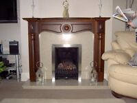 Wooden fireplace surround,marble back panel and hearth with working gas fire