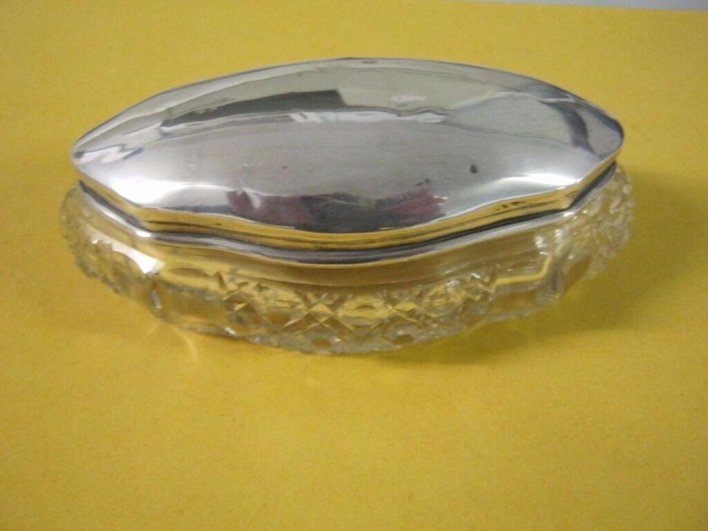 A silver hallmarked top glass trinket box