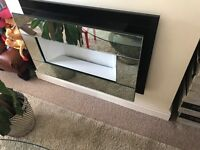 Mirrored electric fire place