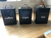 Black tea coffee and sugar tins
