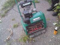 Qualcast petrol Lawnmower ,comes with lawn rake cartridge
