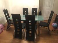 Glass Extendable dining table + 6 chairs