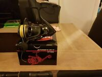 Penn conflict cft 5000 spinning reel loaded with 50lb power pr braid