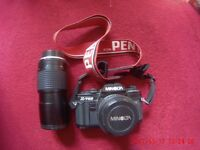 MINOLTA X-700 (with extra lense and strap)