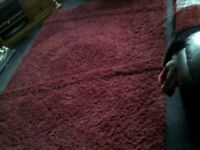 HEAVY DUTY RED RUG IN EXCELLENT CONDITION SIZE 64 X 89 INCHES