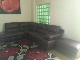 Brown corner leather sofa and footstool. Mint condition