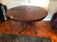 Lovely round dining table and four chairs.