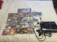 Ps3 console+ 3 wireless controlles +27 games and Guitar hero