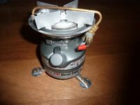 NEW UNUSED COLEMAN FEATHER CAMPING STOVE