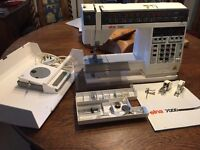 Elna 7000 sewing machine with accessories and manual
