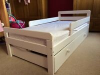 White wood toddler bed with under bed storage