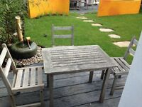 Small rectangular teak table and three chairs