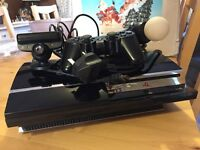 Unboxed PS3, all wires, controller, Kinect wand and microphone camera.