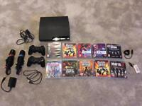 PS3 slim 120gb with Singstar and Guitar hero