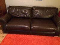 3 seater brown leather sofa and armchair. Bought from Reid's. Measurement 85 cm by 85 cm,2 m long