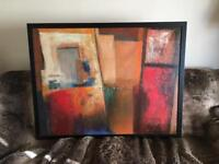 Large painting with black frame