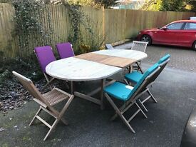 Extending patio table with 6 chairs, 4 chair cushions and parasol (no base).