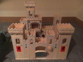 A kids wooden toy castle
