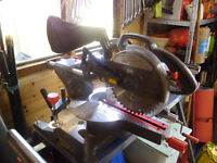 An 1800w Mitre saw, Tool stand and new spare saw blades