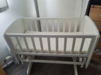 White cradle and matress