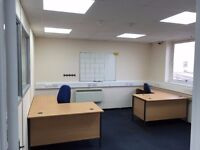Office to rent, including 2 corner desks and 2 office chairs.