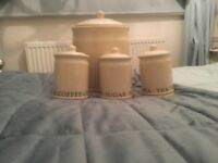 Ex dunelm bread bin with matching sugar, coffee and tea canisters.