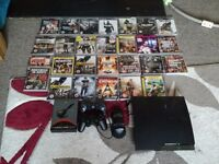 Play station 3 with 27 games and headset and 2 controllers