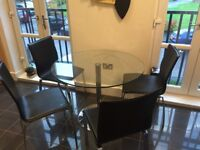Barker and Stonehouse Glass Circular table with free black leather chairs