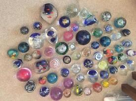 61 Glass paperweights who knows what there worth